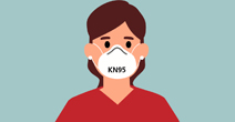 student wearing a face mask giving a thumbs up