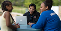 photo of a CCBC mentor chatting with other CCBC students
