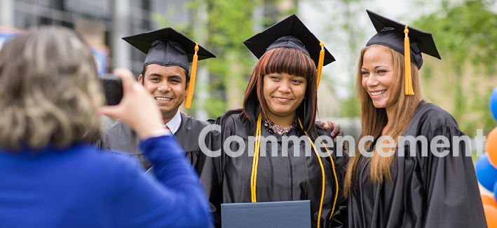 CCBC students after commencement in cap and gown