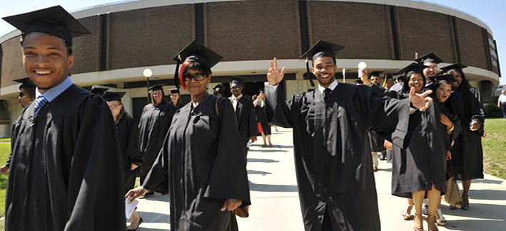 CCBC students wave in cap and gowns