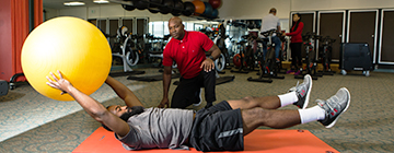 Male student working out with a trainer at the CCBC Fitness Center